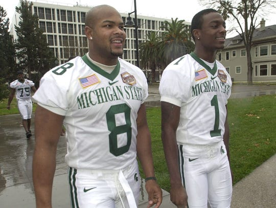 MSU 's T.J. Duckett and Charles Rogers walk through