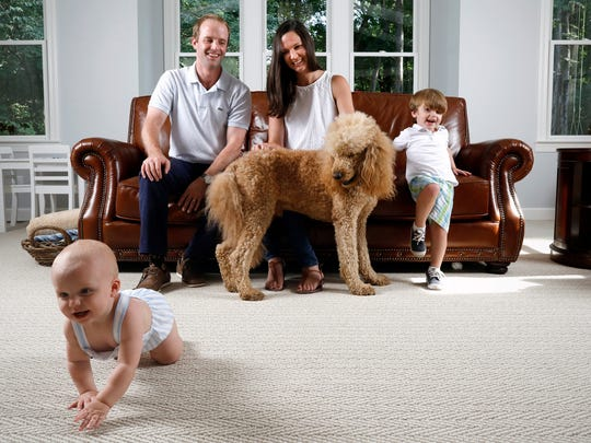 Sarah and Will Schaedle with sons Joe and Eli, and their apricot standard poodle, Bear.