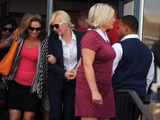 Molly Shattuck, second from left, leaves the Sussex County Courthouse in Georgetown, Delaware on Friday. The former Baltimore Ravens cheerleader was sentenced to two years of probation after pleading guilty to raping a 15-year-old boy at a vacation rental home in Delaware.