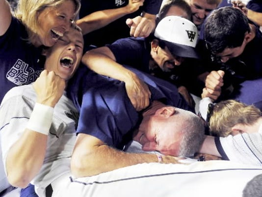 West York's Brandon Kinneman celebrates in a dogpile among his fellow players and coaching staff after defeating Lampeter-Strasburg, 9-6, for the school's first state championship in baseball last year at Penn State in State College. Kinneman takes over the No. 1 pitcher's spot for the Bulldogs. (DAILY RECORD/SUNDAY NEWS - FILE)