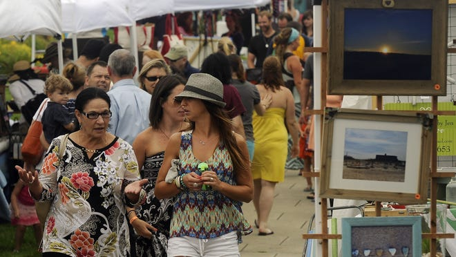 Crowds visit local business booths in 2014 at the first  Love Live Local Festival at Aselton Park in Hyannis. For the first time earlier this month, the festival was forced to go online because of concerns about COVID-19.