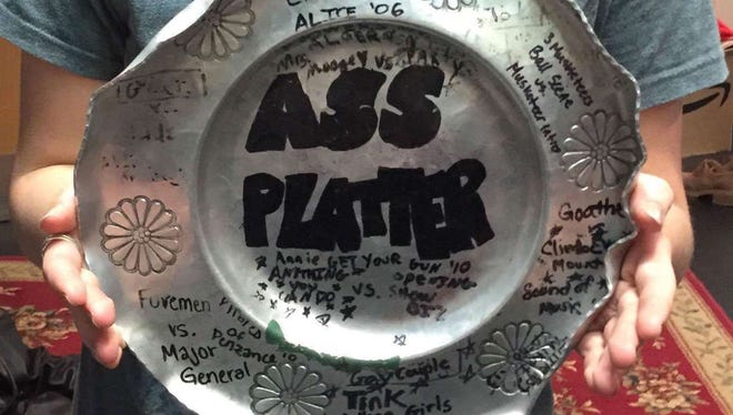 """A Homestead High School theater tradition has led to the suspension of teacher Amelia Figg-Franzoi. The tradition involves a friendly competition among students over the most-popular scene in a theater production. The winning students spank the runners-up with a dinner plate called the """"Ass Platter."""""""
