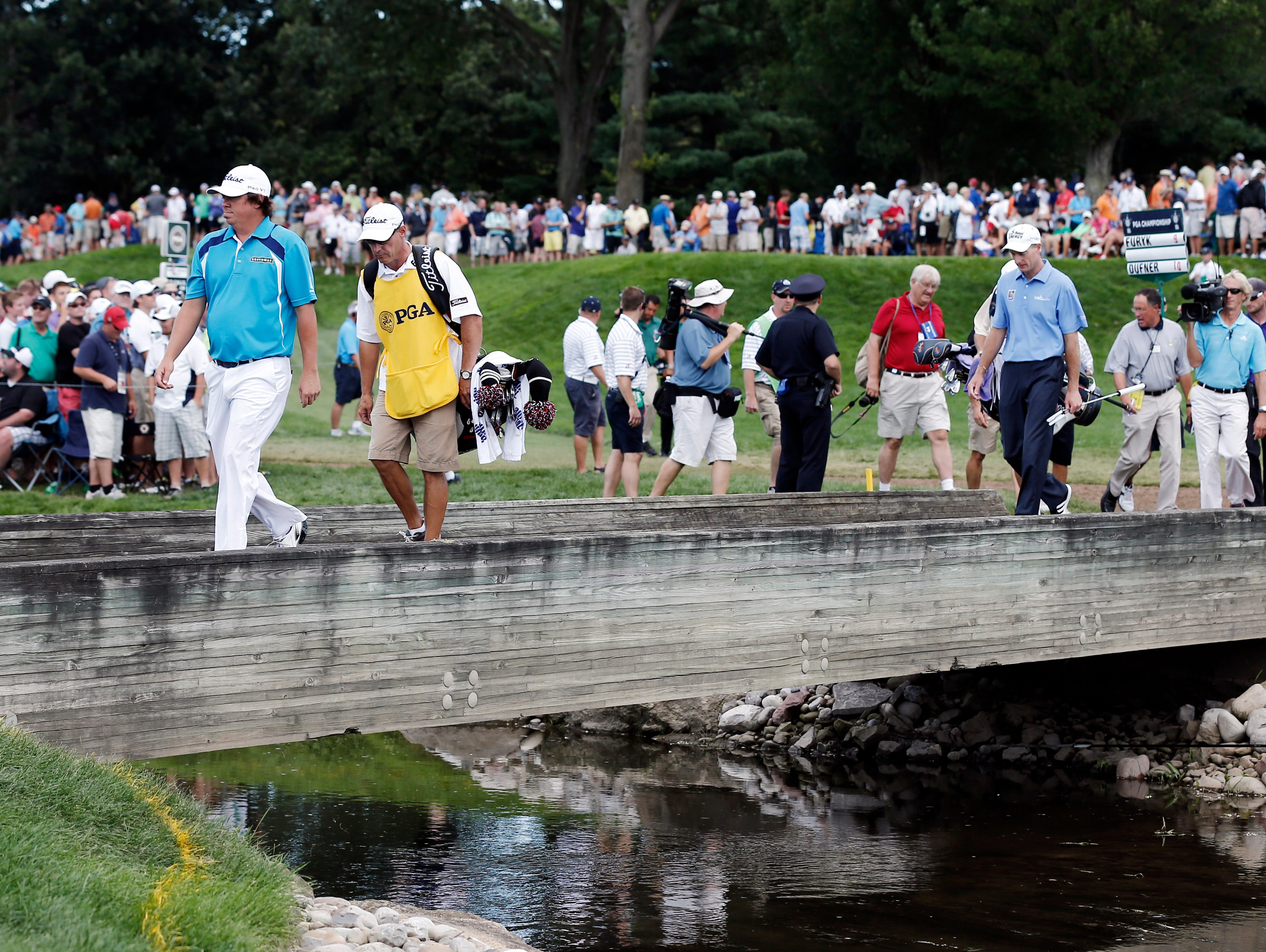 Jason Dufner and Jim Furyk walk to the No. 6 green.