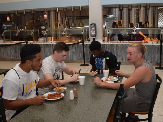 LSUA students Raydel Naotala (left) of Hawaii, John Oregan of Ireland, Hendriks Joseph from the Caribbean and Matthew Benham of England eat at the new Magnolia Café located in the Student Center on campus.