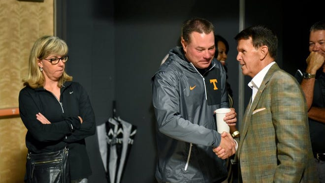 Tennessee Vice Chancellor and Director of Athletics Dave Hart greets Butch Jones as he arrives to announced Thursday his retirement from the position of director of athletics effective June 30, 2017.