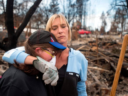 Tanya Williams, right, consoles her neighbor, Dawn
