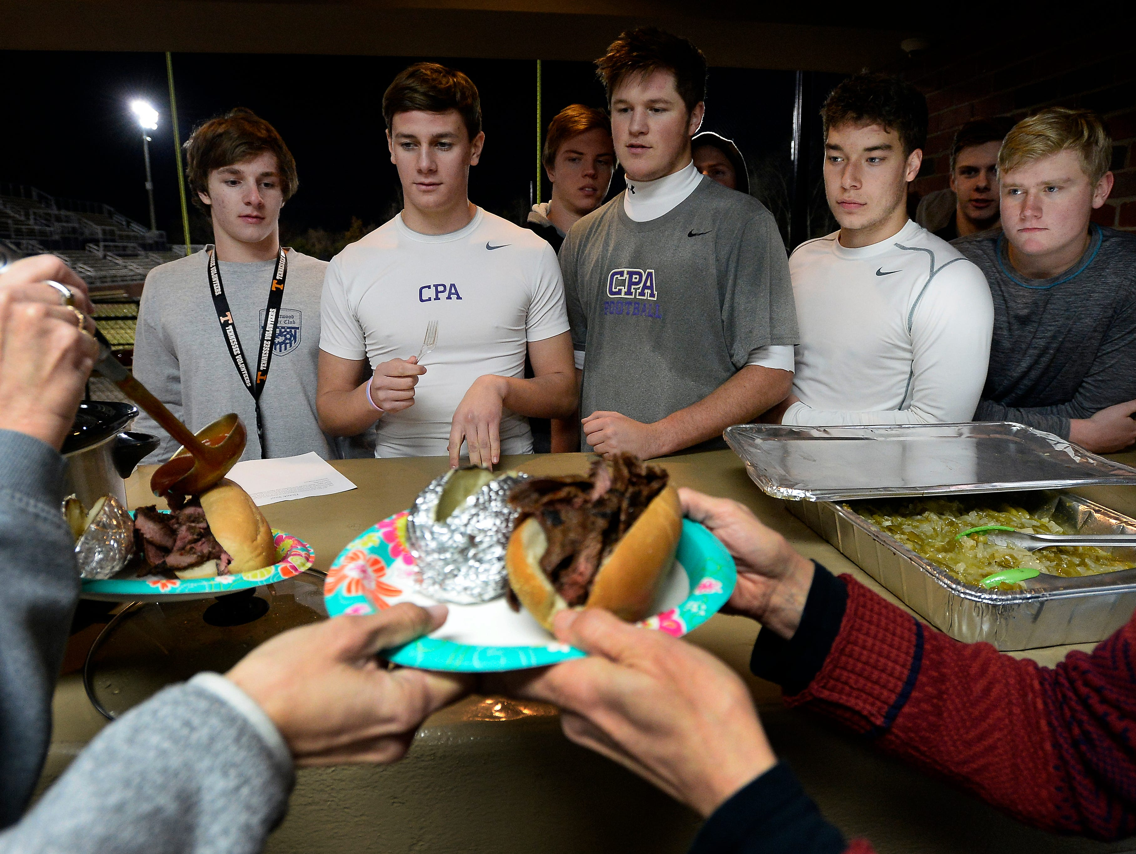 CPA football players are served an early Thanksgiving holiday team dinner after practice. The dinner, which included flank steak, salad, potatoes and homemade desert, was held after practice at Christ Presbyterian Academy on Tuesday, Nov. 24, 2015 in Nashville, Tenn.