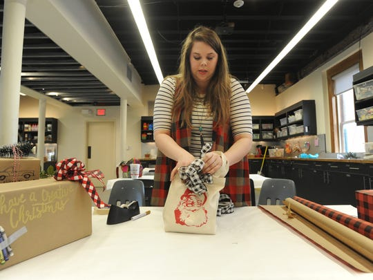 Rebecca Bridges shows the Reporter-News some gift-wrapping techniques.