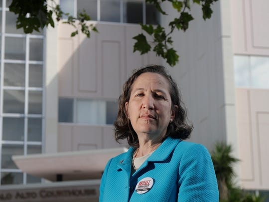 In this Monday photo, Stanford University law professor Michele Dauber poses outside the Palo Alto courthouse. Judge Aaron Persky says he would handle the sexual assault case of former Stanford swimmer Brock Turner the same way today as he did almost exactly two years ago, even though it's the reason why he is the target of a June 5 recall election in Santa Clara County. Persky sentenced Turner to six months in jail.