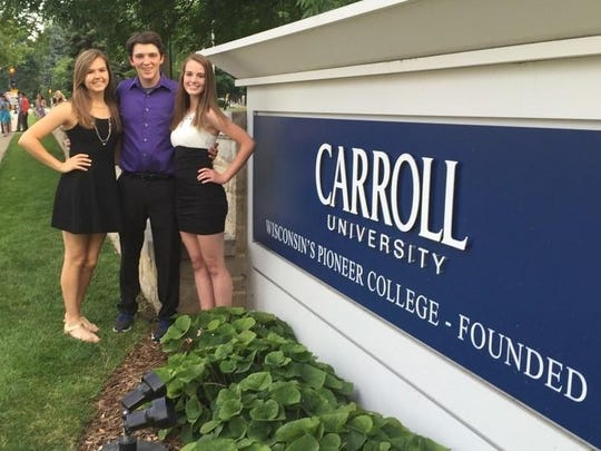 From left, Sarah Greene, Shane Lehman and Isabel Strazny pose outside of Carroll University, where the students spent a week for the World Affairs Seminar.