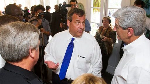 New Jersey Gov. Chris Christie, center, meets with first responders who traveled to his state to assist in the Hurricane Sandy response while attending an event with Gov. Phil Bryant in Biloxi Wednesday.