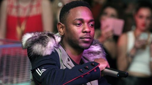 Recording artist Kendrick Lamar performs at the Maxim Magazine Super Bowl Party in thisfile photo taken in New York. Lamar said Saturday night he was grateful to hear about Swift knowing the words to his lyrics and putting her in a great mood.