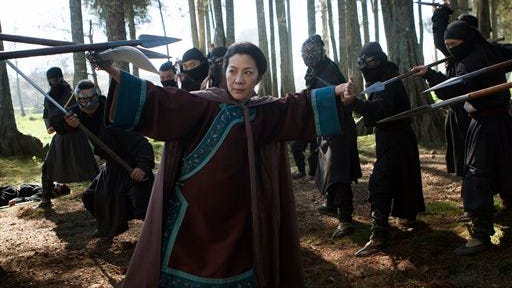 """In this image released by Netflix, Michelle Yeoh appears in a scene from""""Crouching Tiger, Hidden Dragon: The Green Legend,"""" which will premiere on Netflix and in selected global IMAX theaters on Aug. 28, 2015."""