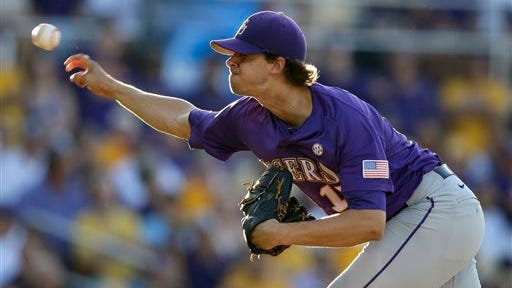 LSU pitcher Aaron Nola throws in the first inning of an NCAA college baseball regional tournament game against Houston in Baton Rouge, La., Saturday, May 31, 2014. (AP Photo/Gerald Herbert)