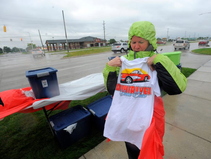 Kimberly Shotwell, of Allen Park tries to fold a Crusin'
