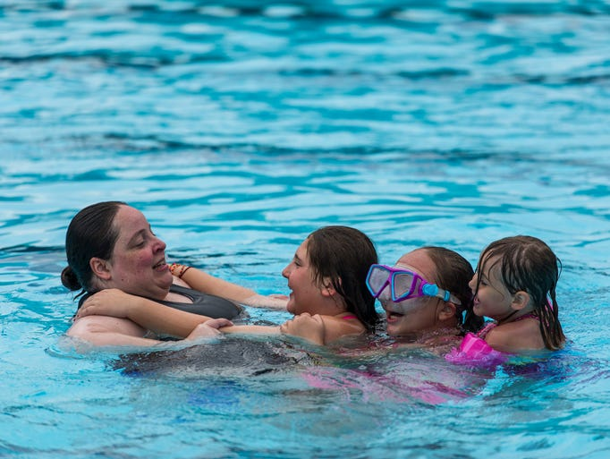 Emily Day (left to right) pulls her niece Hannah Pastore,
