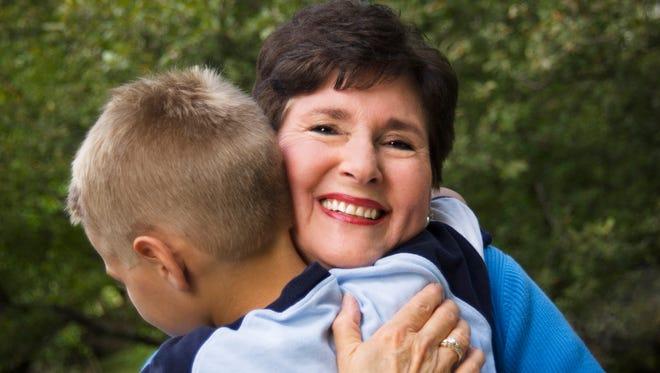 Grandson hugging grandma