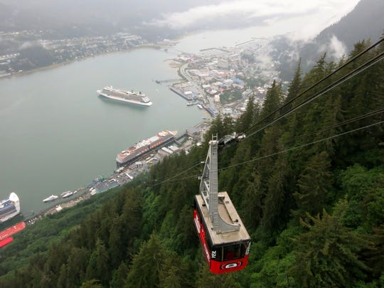The Mount Roberts Tramway offers an aerial view of cruise ships anchored in Juneau, Alaska. Juneau, the state capital, is only accessible by boat or plane.