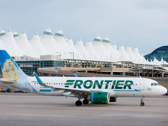 A Frontier Airlines Airbus A320neo taxis out from Denver