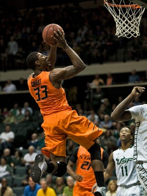 Marcus Smart scored 25 points to power Oklahoma State to a big win against South Florida.