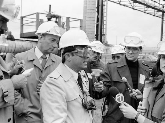 Dow officials speak to reporters in November 1985 near the site of a Dow Chemical Canada spill on the St. Clair River.