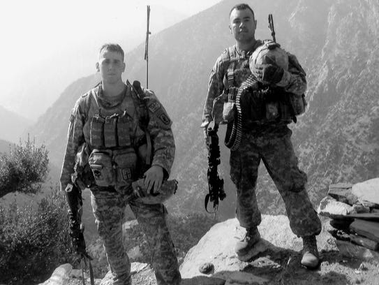 Sgt. Ryan Pitts, left, and Sgt. Israel Garcia in Afghanistan.