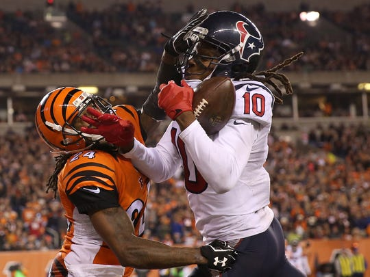 Houston Texans wide receiver DeAndre Hopkins catches a touchdown pass over Cincinnati Bengals cornerback Adam Jones in the fourth quarter in the Bengals' 10-6 loss.