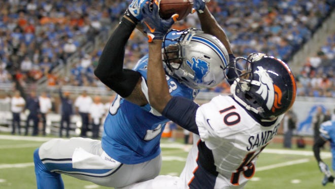 Broncos WR Emmanuel Sanders makes pass reception against Lions CB Darius Slay in the fourth quarter Sunday at Ford Field.