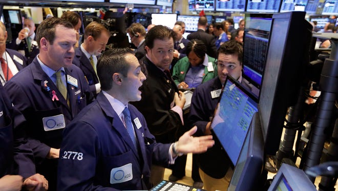 Traders work on the floor of the New York Stock Exchange on March 12.