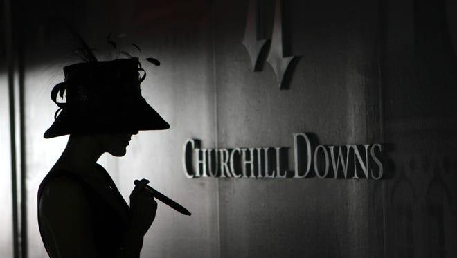 In the inner sanctum of Churchill Downs, Tana Leggo enjoys a Hemingway Classic by Arturo Fuente.