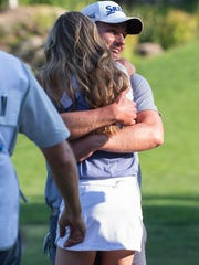 Andrew Putnam gets a hug from his wife after winning