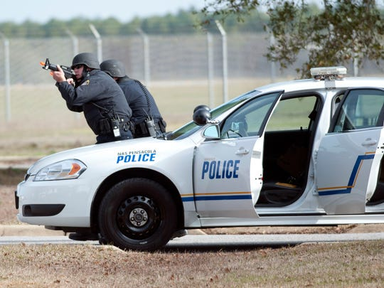 Pensacola Naval Air Station security personnel conduct a force training exercise at Sherman Field Thursday morning. The exercise was conducted in support of Solid Curtain-Citadel Shield 2015.
