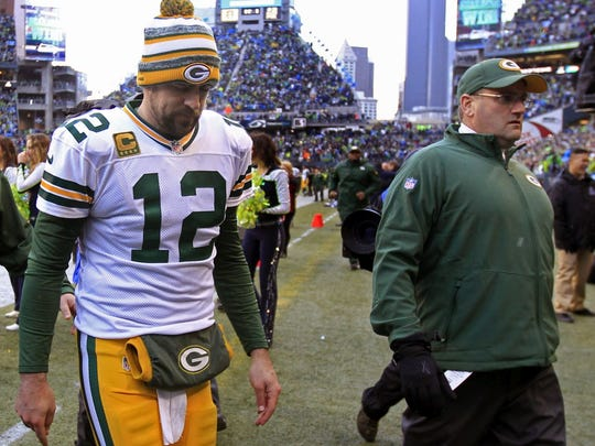 Green Bay Packers' Aaron Rodgers leaves the field following the Packers' 28-22 overtime loss to Seattle on Sunday, Jan. 18, 2015 at CenturyLink Field in Seattle.