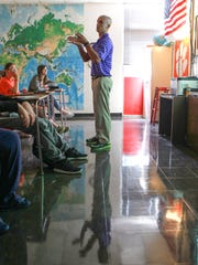 Palmetto High School U.S. History teacher Taylor Hollifield leads a discussion with students. Minutes after talking about a lesson about the beginning of the United States history, he talked to the class about the events of September 11, 2001 to his students who were infants at the time.