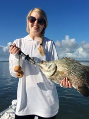 Margaret Davis with a fine tripletail she caught while