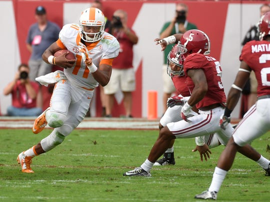 Tennessee Volunteers quarterback Joshua Dobbs (11) scrambles up the middle against the Alabama Crimson Tide during last year's game.