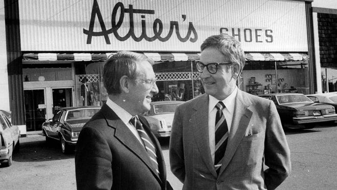 From left, Richard J. Altier, president, and his brother Theodore J. Altier, chairman of treasurer, stand outside the Altier's Shoes in Brighton's Twelve Corners in 1979.