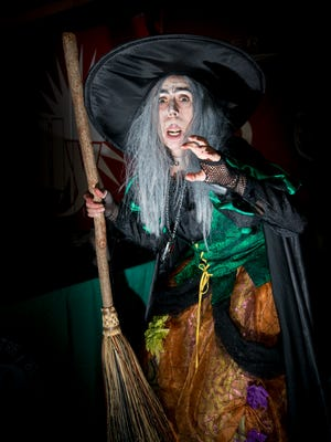 Broomhilda greats guests as they are about to enter the Field of Screams at Blue Wahoos Stadium in Pensacola on Wednesday, October 18, 2017.  The Halloween experience is being hosted by the Blue Wahoos and Pensacola Little Theatre.