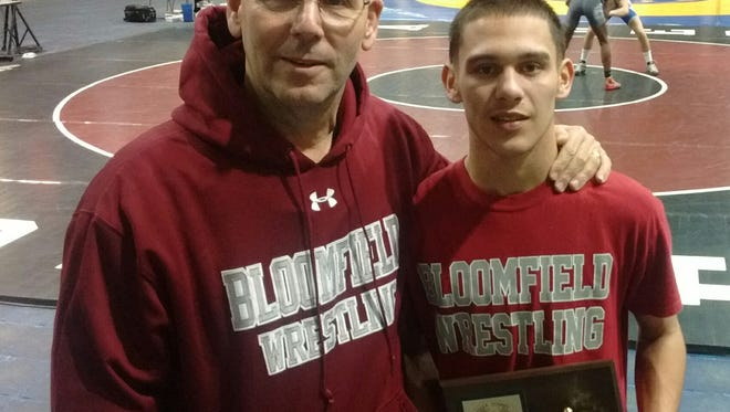 Bloomfield coach Sam Fusaro and Angel Mercado, who finished third at 113 pounds in Essex County tournament.