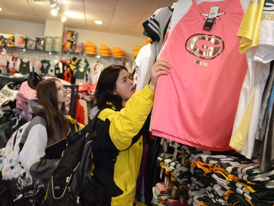Brandy Council, Charlotte, N.C., and her daughter, Juliana, shop Tuesday at the Airport Gift Shop at Austin Straubel International Airport in Ashwaubenon.