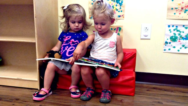 Hattie, right, and her cousin Kaylin at day care.