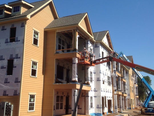 Crews work on Springfield Luxury Apartments, which