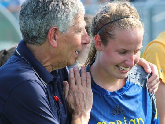 Veteran head coach Barry Brodsky congratulates senior