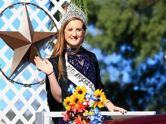 Nueces County Junior Livestock Show 2015 Queen Bailey McLendon waves to a crowd during the 81st Annual Nueces County Junior Livestock Show Parade on Saturday, Jan. 9, 2016, in Robstown.