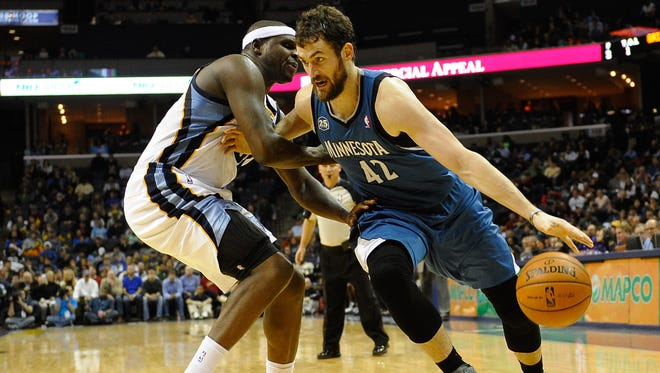 Minnesota Timberwolves power forward Kevin Love (42) and Memphis Grizzlies power forward Zach Randolph (50) are trying to push their teams into the playoffs.