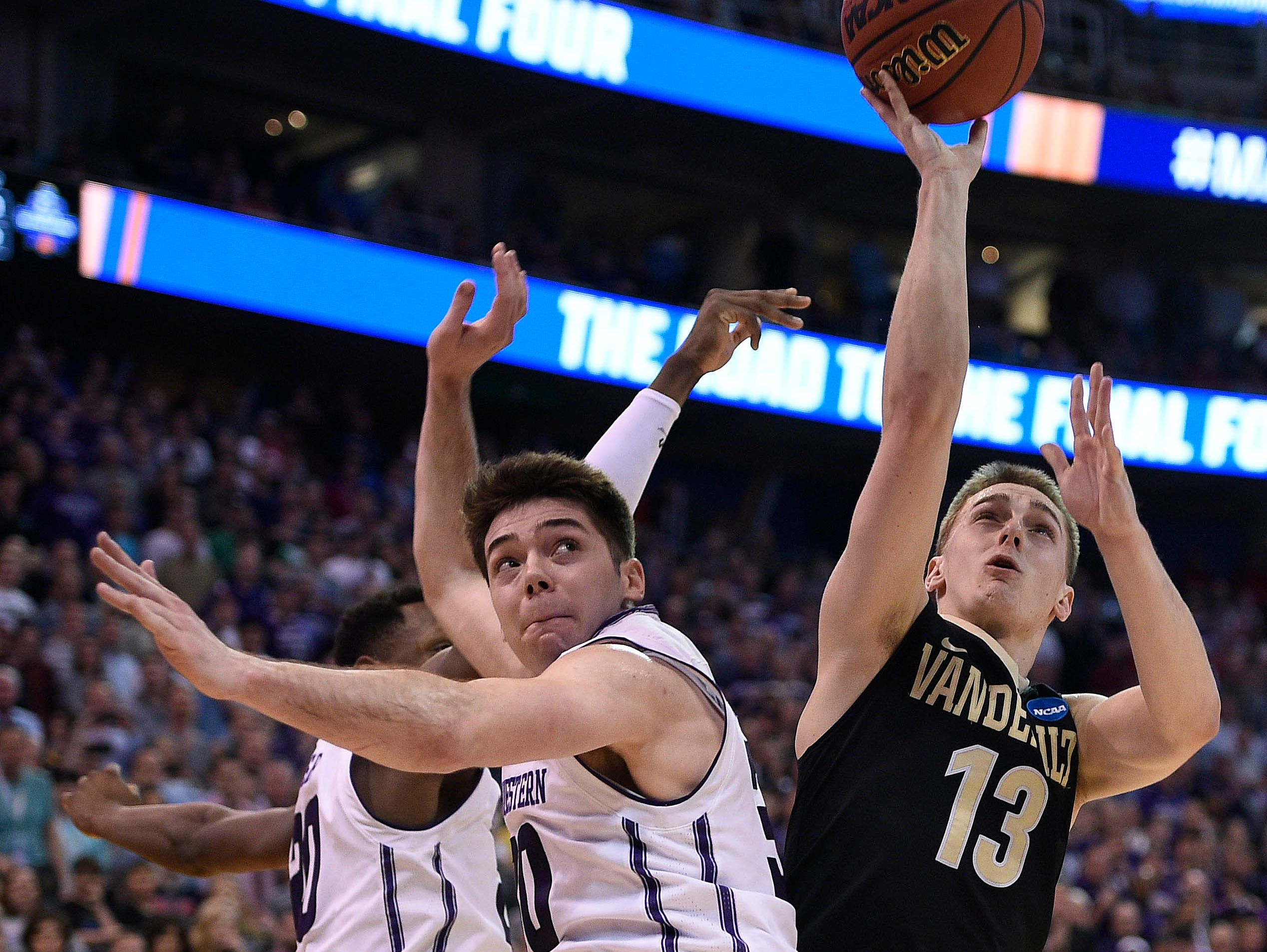 Vanderbilt guard Riley LaChance (13) shoots against Northwestern guard Bryant McIntosh (30) during the second half of the NCAA tournament first-round game in Salt Lake City on March 16, 2017.
