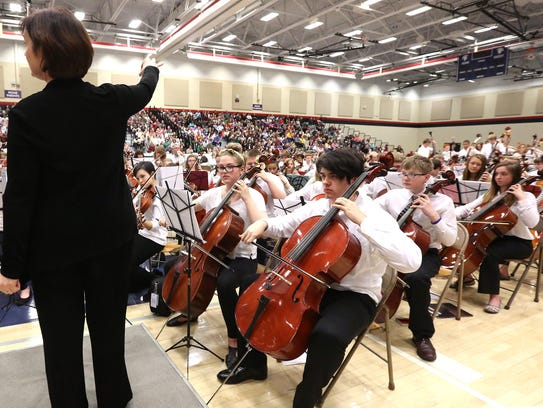 The Wauwatosa Middle School Festival Orchestra is shown