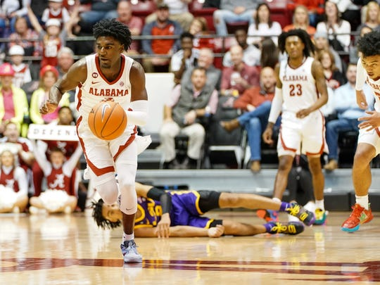 Feb 15, 2020; Tuscaloosa, Alabama, USA; Alabama Crimson Tide guard Kira Lewis Jr. (2) drives the ball to the basket against LSU Tigers during the second half at Coleman Coliseum. Mandatory Credit: Marvin Gentry-USA TODAY Sports