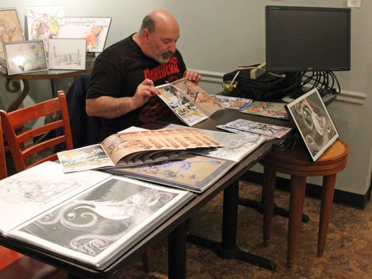 Illustrator Delfino Falciani displays his works at Casciano Coffee Bar and Sweetery during Third Thursday.