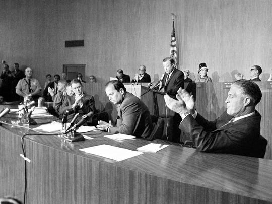 Walter Reuther, President of the United Auto Workers Union (at podium) pledges the help of his union in the rebuilding of the ravaged arms of Detroit, July 27, 1967 to the applause of Gov. George Romney, right. Mayor Jerome Cavanagh is at center, Cyrus Vance, next left, President Johnson's personal emissary and Lt. Gen. John Throckmorton, the military commander of the city, left.
